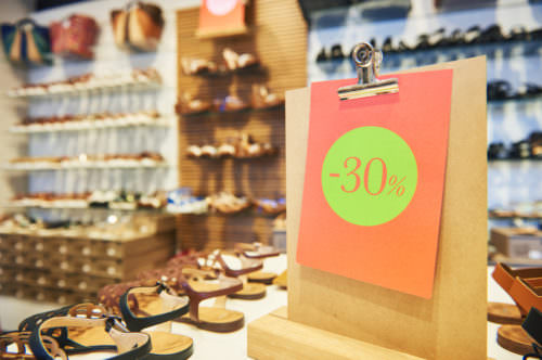 Shopping sale. seasonal price discount on footwear in shoe shop store